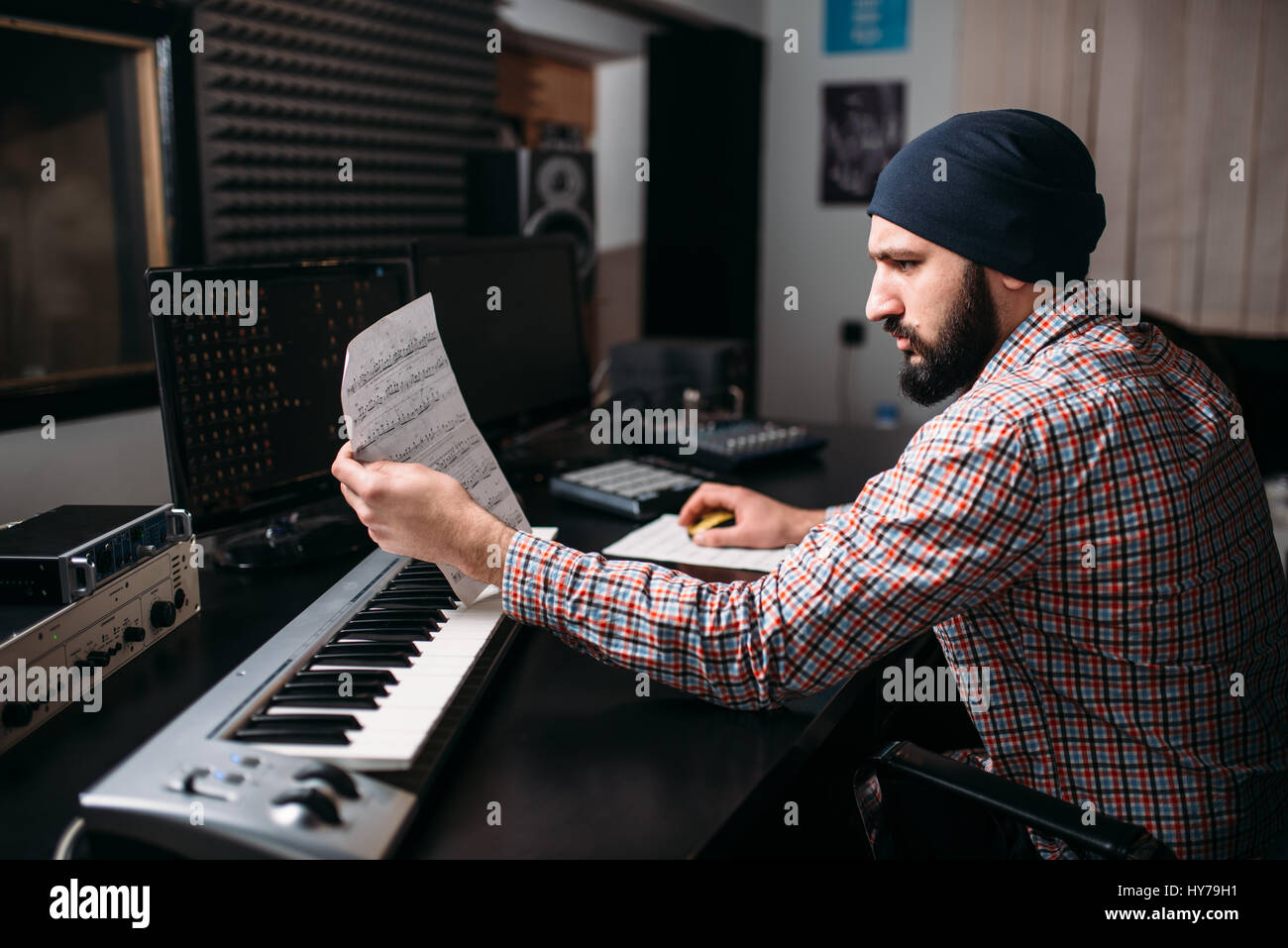 Audio engineering, sound producer work with synthesizer in studio. Professional digital media technology - Stock Image