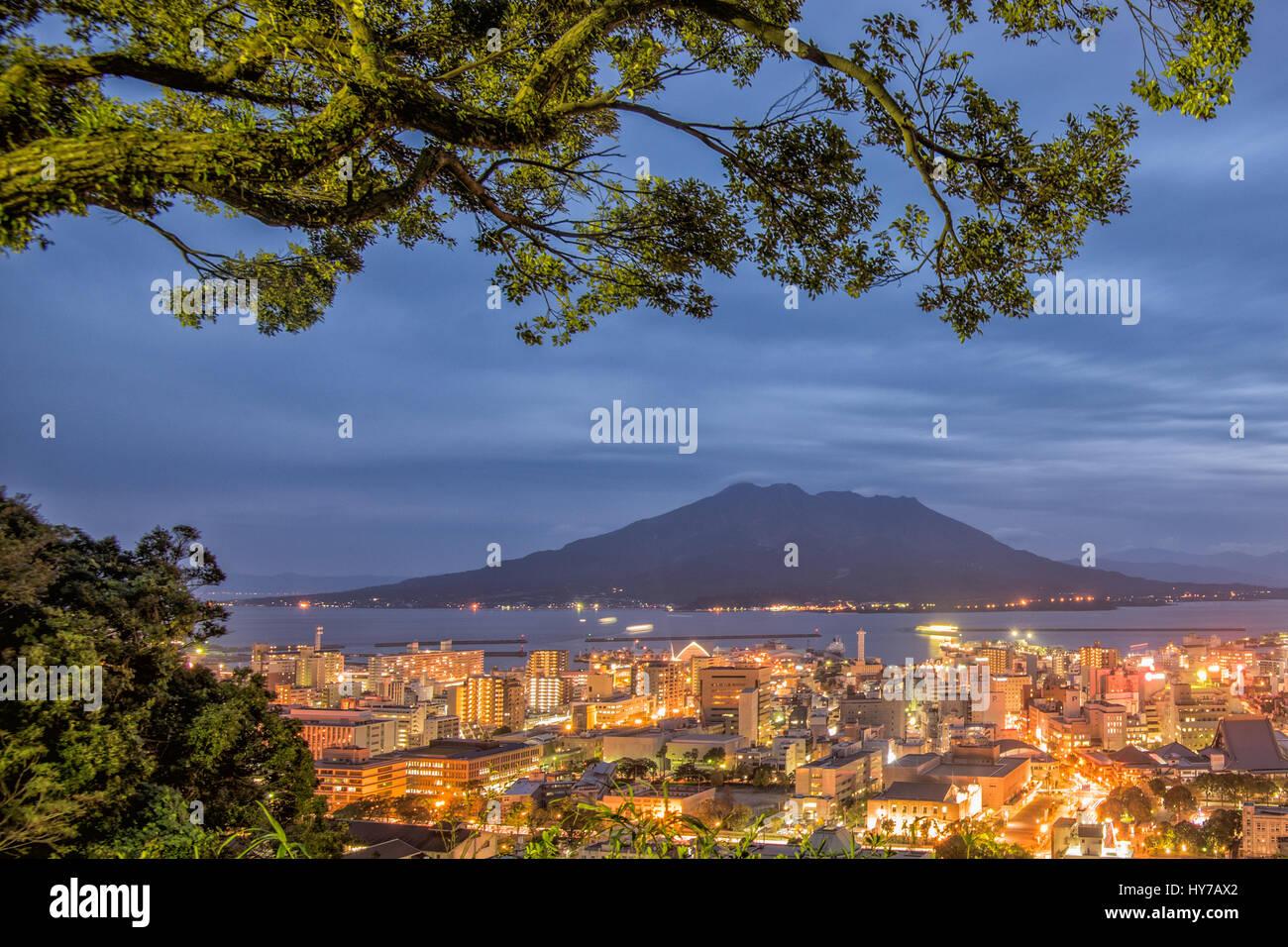 Twilight Sakurajima Volcano and Kagoshima City View from Shiroyama Viewpoint, Yakushima Island, Kyushu, Japan - Stock Image