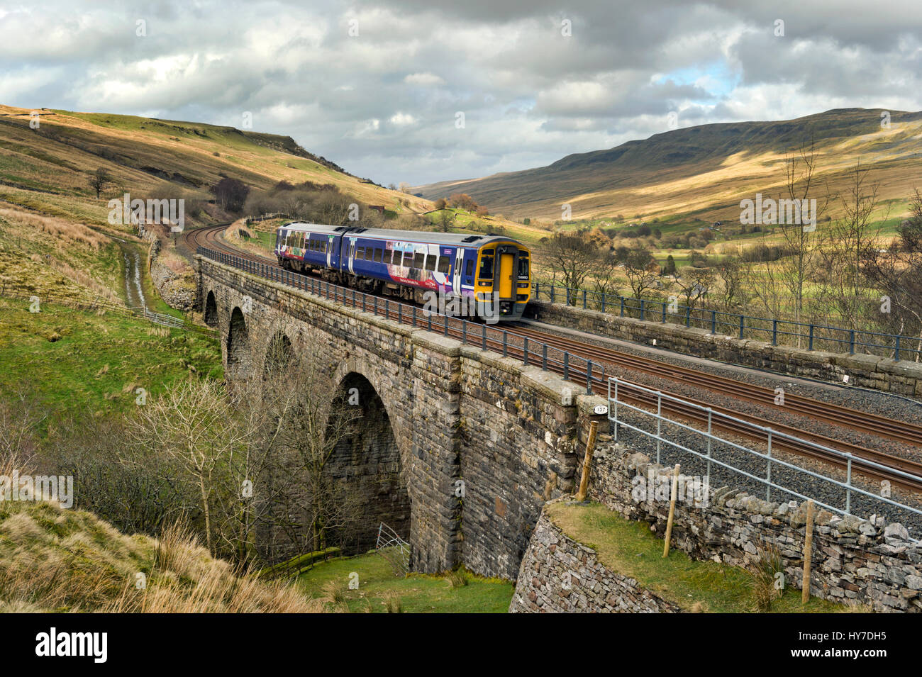 Sprinter train at Ais Gill Viaduct, Mallerstang, Eden Valley, Cumbria, en route to Leeds on the first day of re - Stock Image