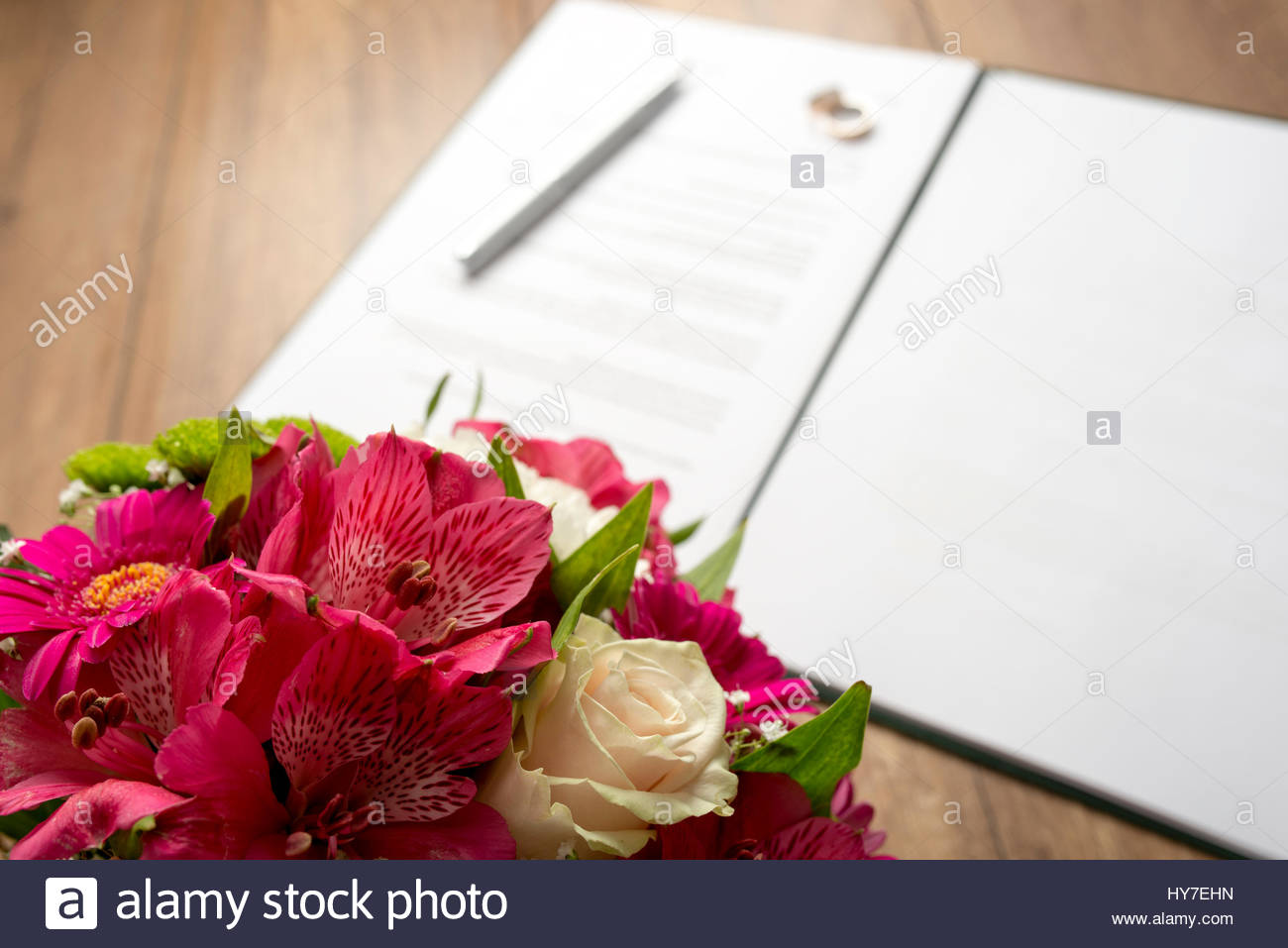 Marriage Contract with Pen and Bouquet of Fresh Beautiful Flowers on ...