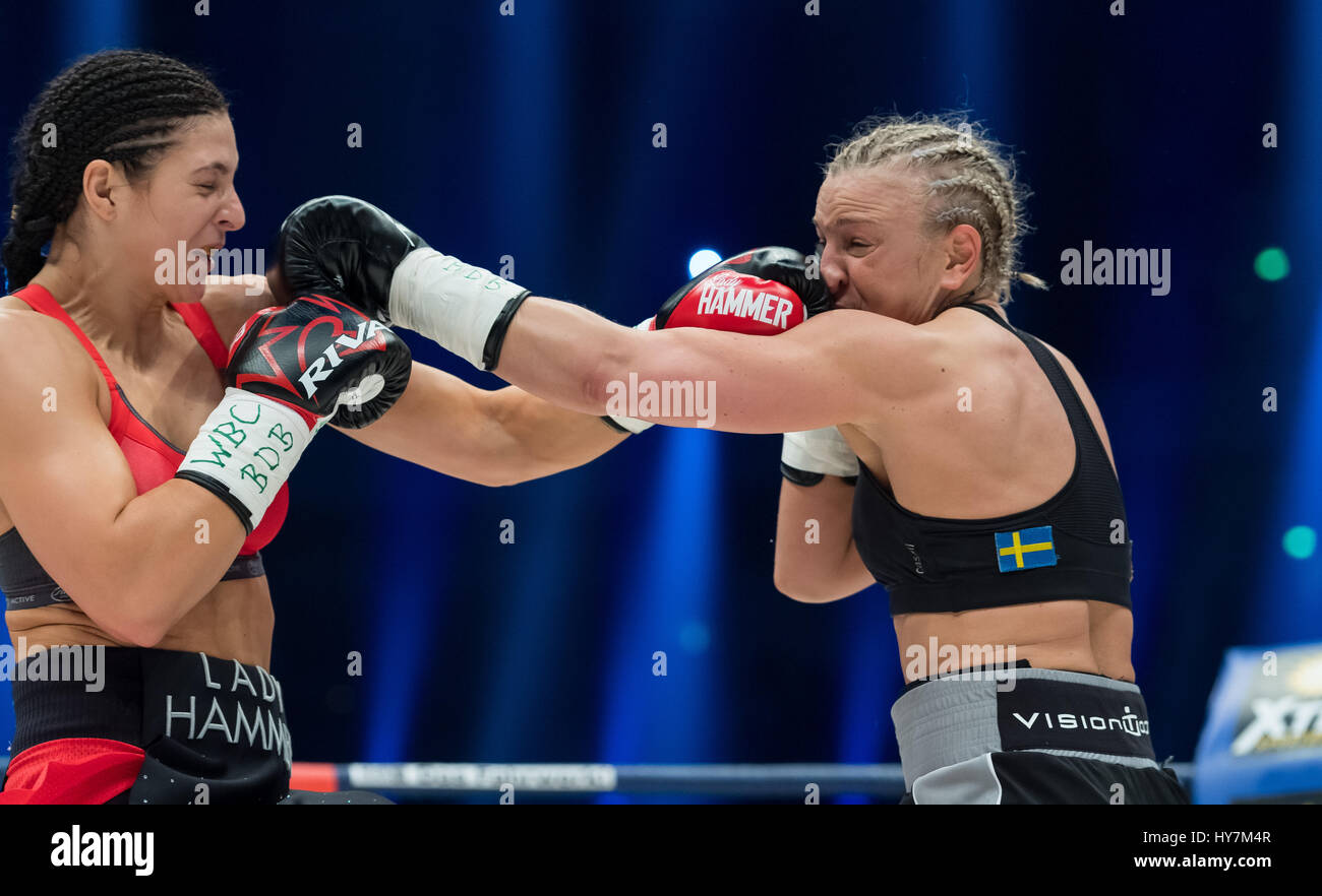 Dortmund, Germany. 1st Apr, 2017. Christina Hammer (l) from Germany and Maria Lindberg from Sweden in action during the women's WBC World Championship fight in Dortmund, Germany, 1 April 2017. Photo: Guido Kirchner/dpa/Alamy Live News Stock Photo