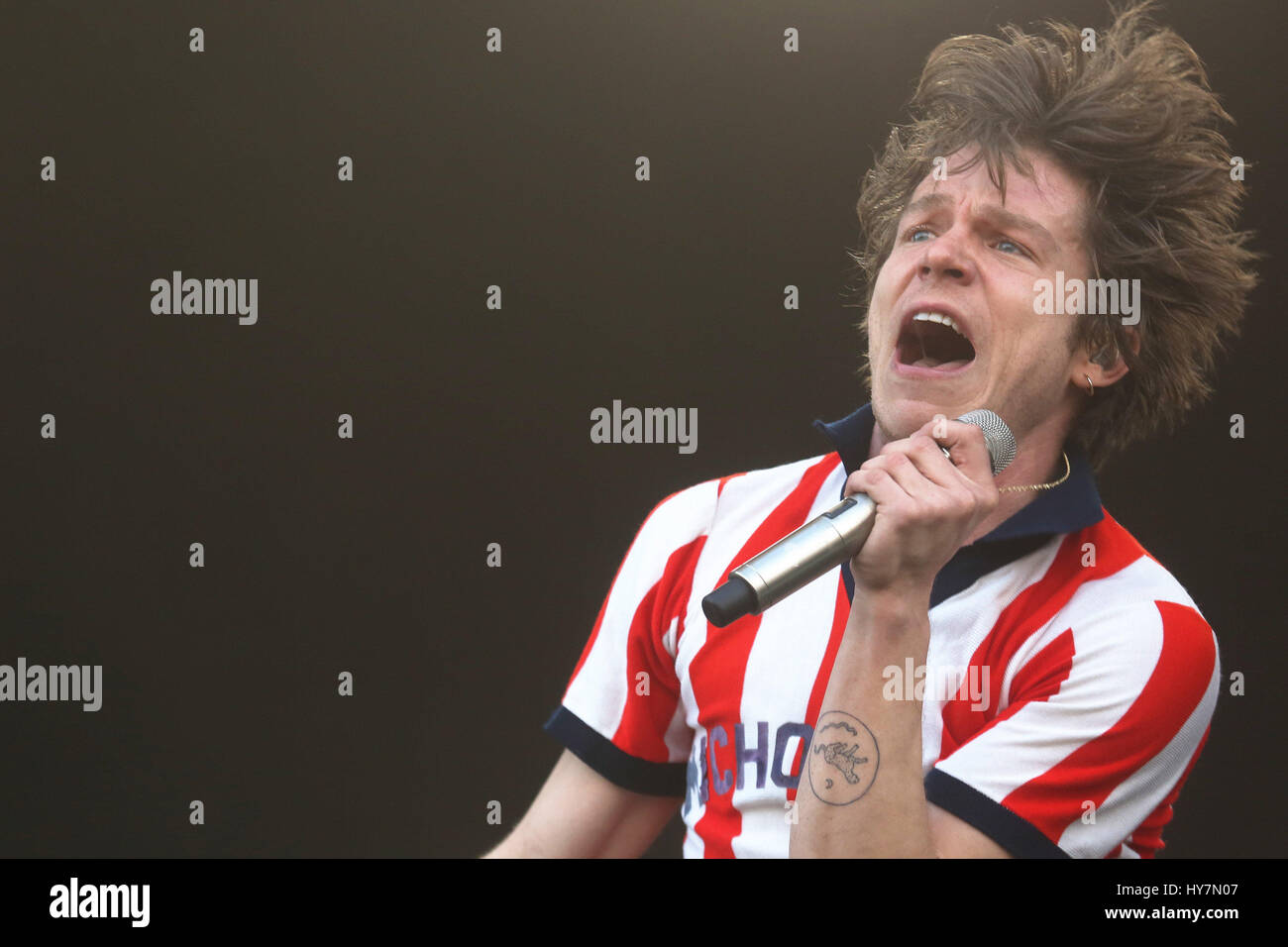 Matt Shultz, singer of the US band Cage the Elephant, performs during a concert at the Lollapalooza Music Festival - Stock Image