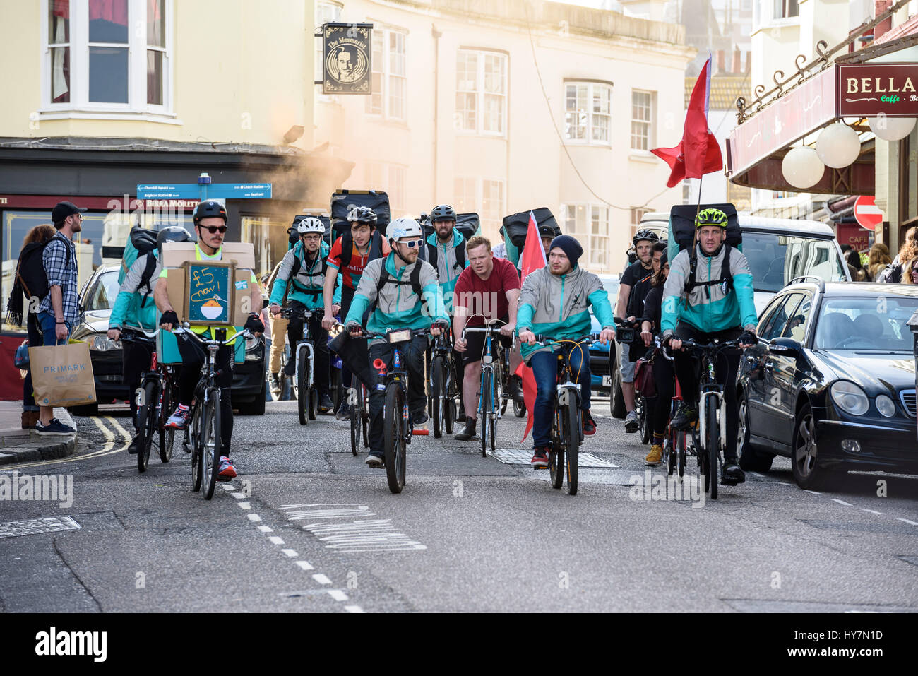 Brighton, UK. 01st Apr, 2017. Bicycling Deliveroo riders in Brighton protest for living wage near Brighton Town - Stock Image