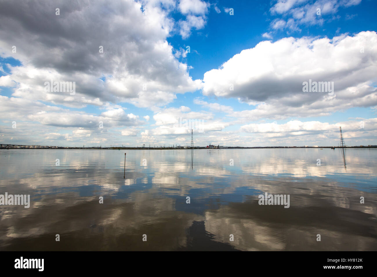 River Thames, London, UK. 2nd Apr, 2017. UK Weather. Fluffy clouds reflected in the calm waters of the Thames at - Stock Image