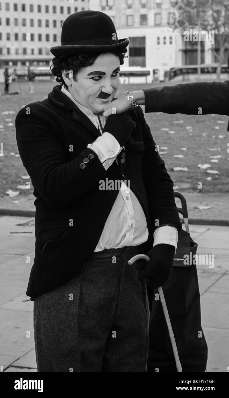 Charlie Chaplin kissing a women's hand B&W - Stock Image