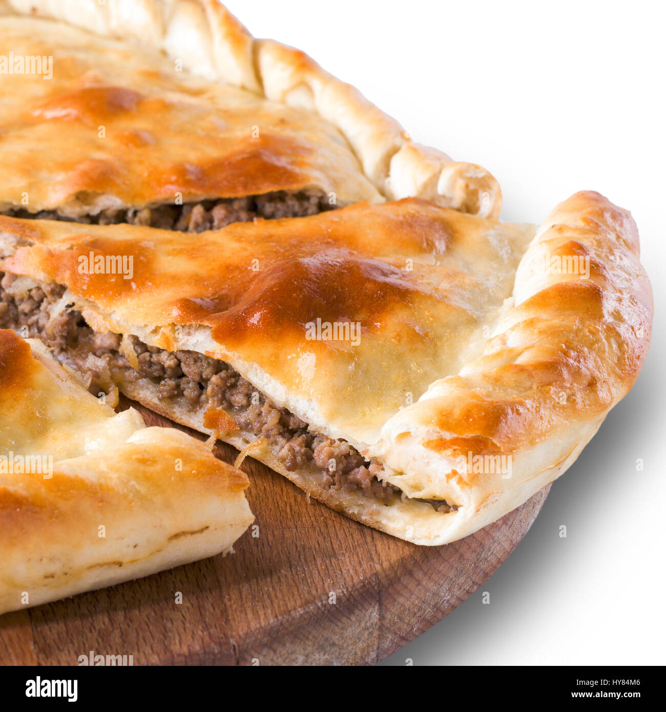 Ossetian pie with meat isolated on white - Stock Image