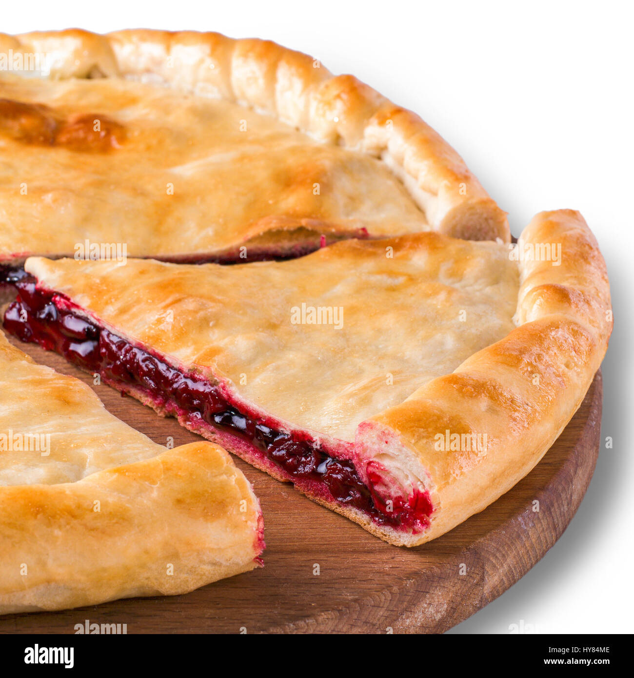 Ossetian pie with cherry isolated on white - Stock Image