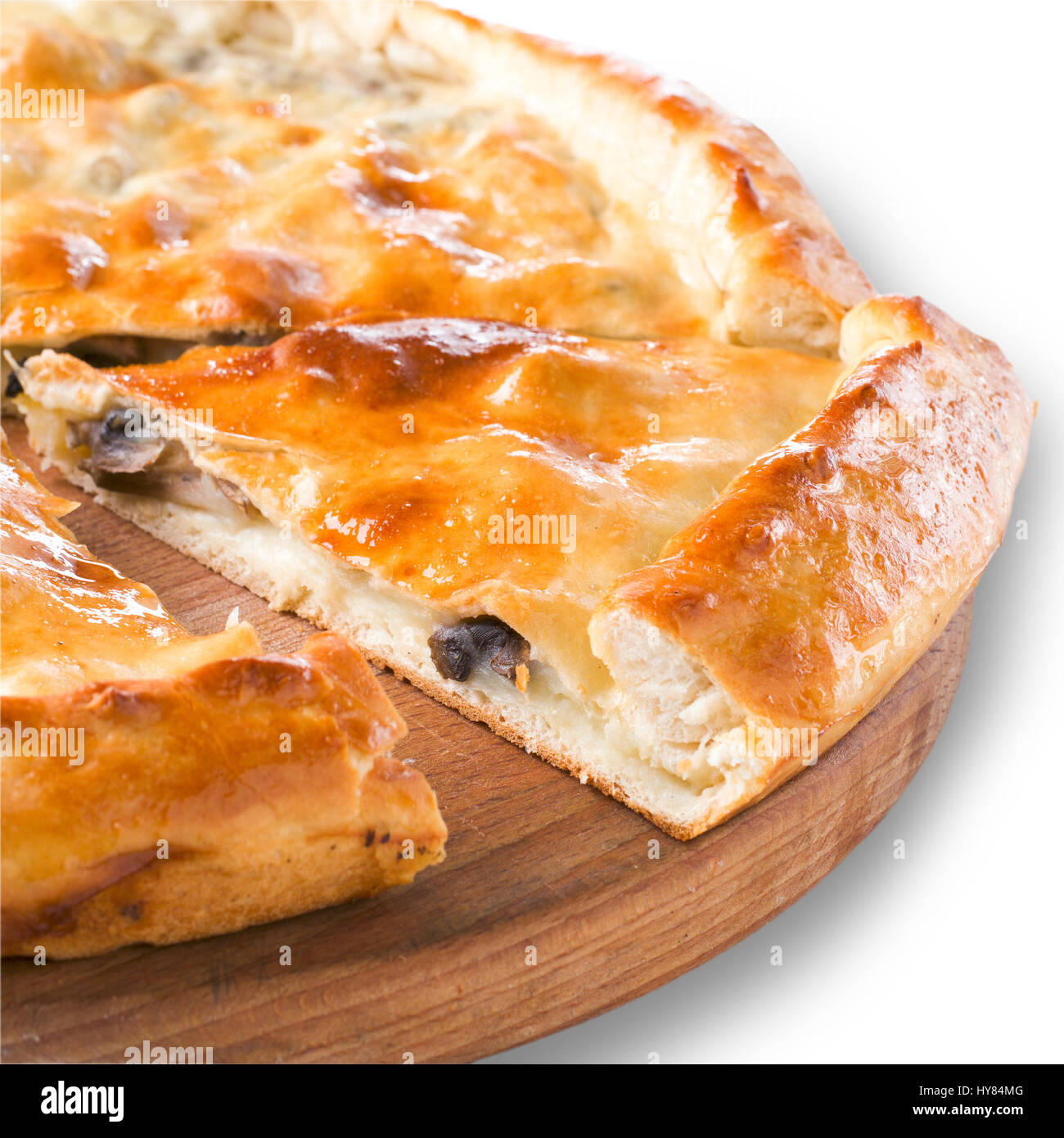 Ossetian pie with potato and mushroom isolated on white - Stock Image