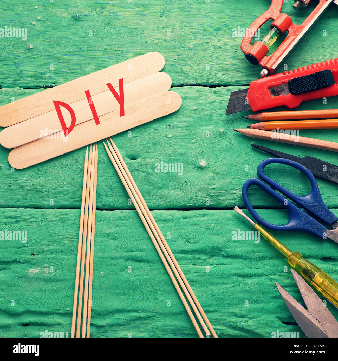 Diy tools background with group of crafting tools like scissors, hammer, knife, equipment for handmade product on - Stock Image