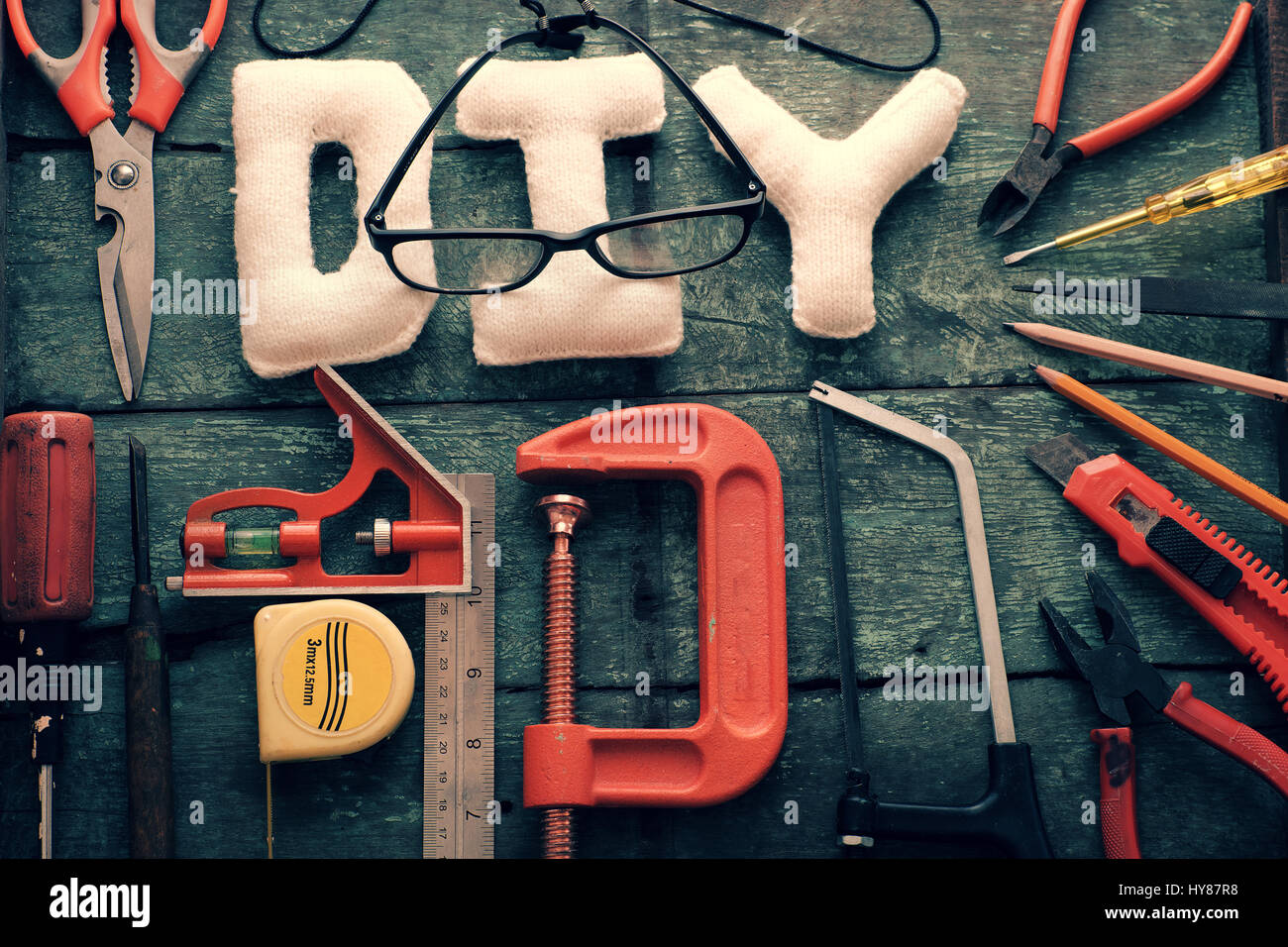 Diy tools background with group of crafting tools like scissors, hammer, knife, equipment for handmade product on Stock Photo