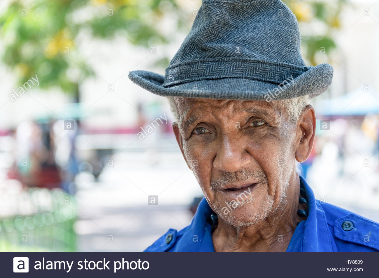 Cuban real people faces man in outdoor urban area in daytime portrait of an old man wearing hat