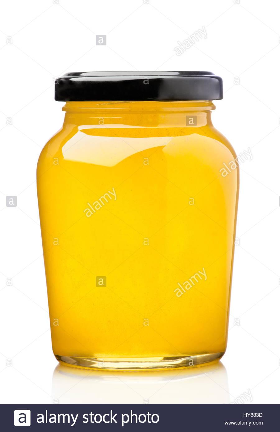 Honey pot preserved, isolated on white - Stock Image