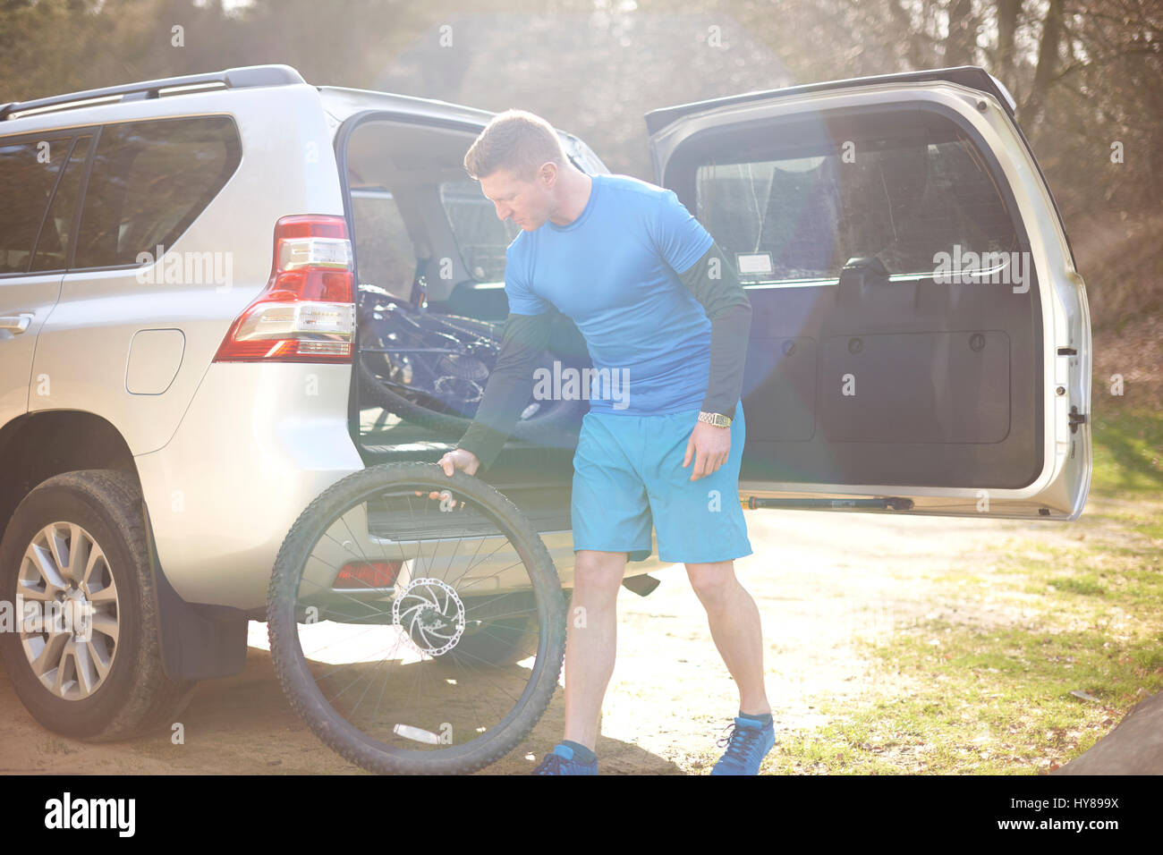 A man prepares to go mountain biking - Stock Image