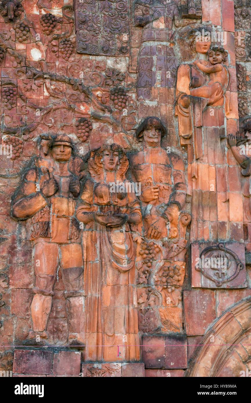 Close-up of faces from communist era on façade of city market, Kutaisi, Imereti Region, Georgia - Stock Image