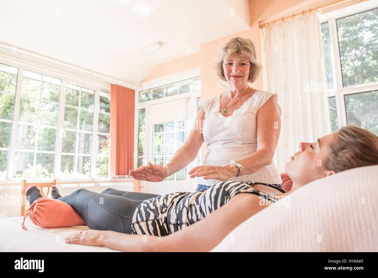 A spiritual healer at work - Stock Image