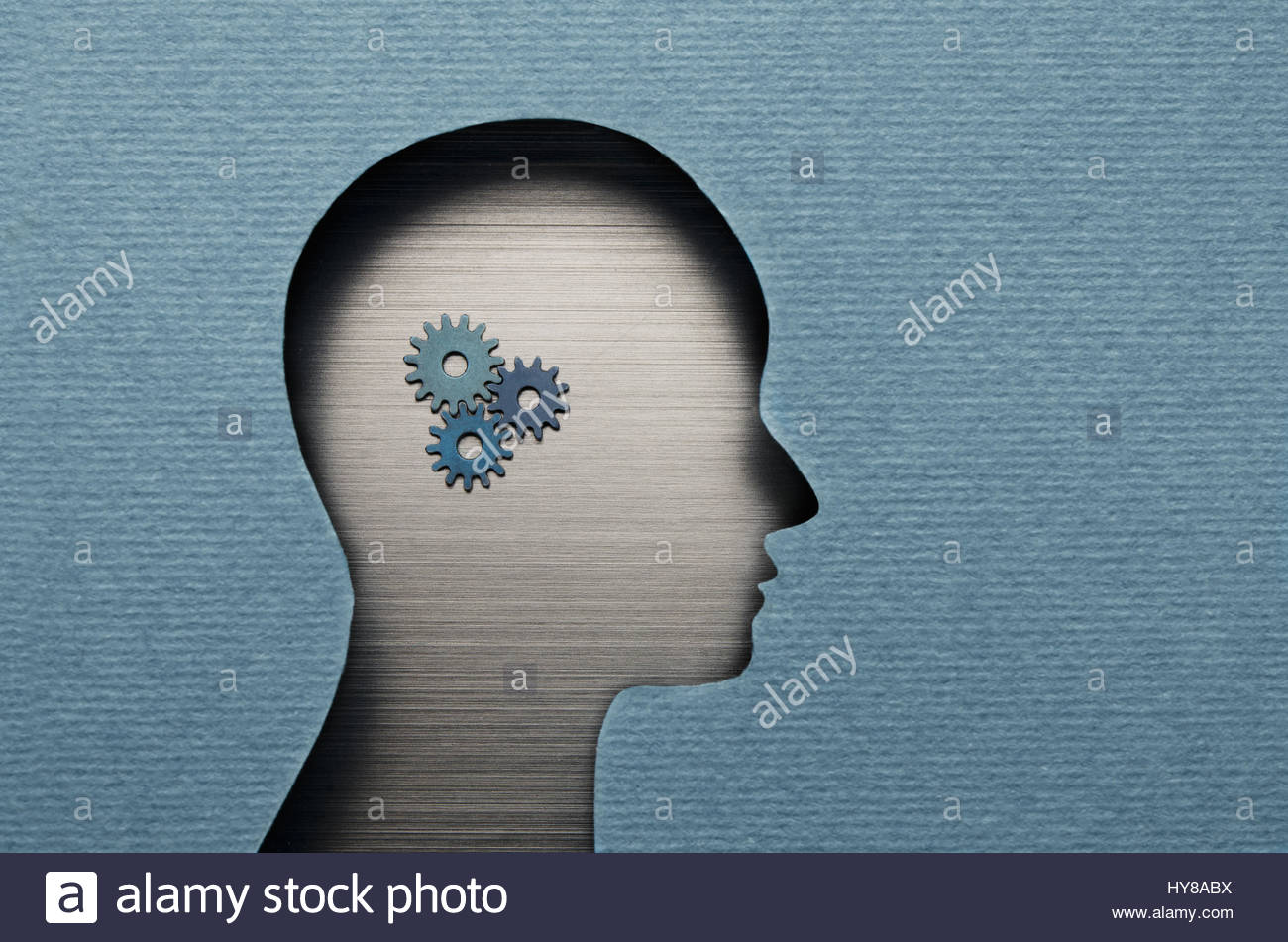 Thinking Mechanism. Human head with gears inside - Stock Image