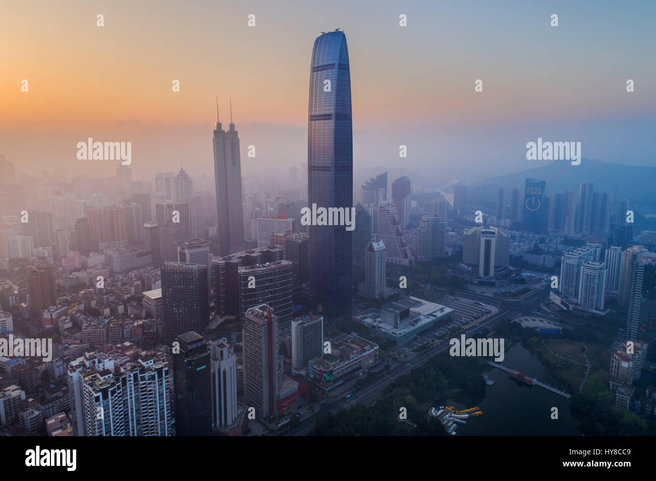 Kingkey 100, a 100 story skyscraper, against a sunrise in Shenzhen, Guangdong, China. It is currently the 14th tallest - Stock Image