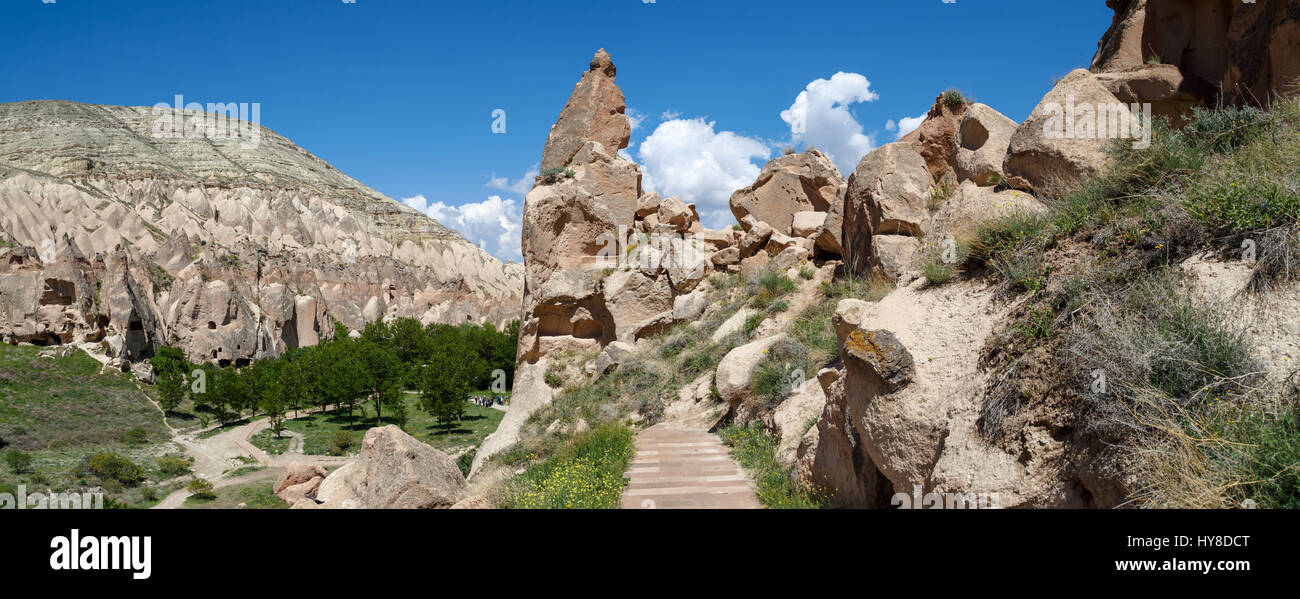View of famous Zelve Open Air Museum with sandy fairy chimneys and tufa caves in Cappadocia area, on cloudy blue - Stock Image
