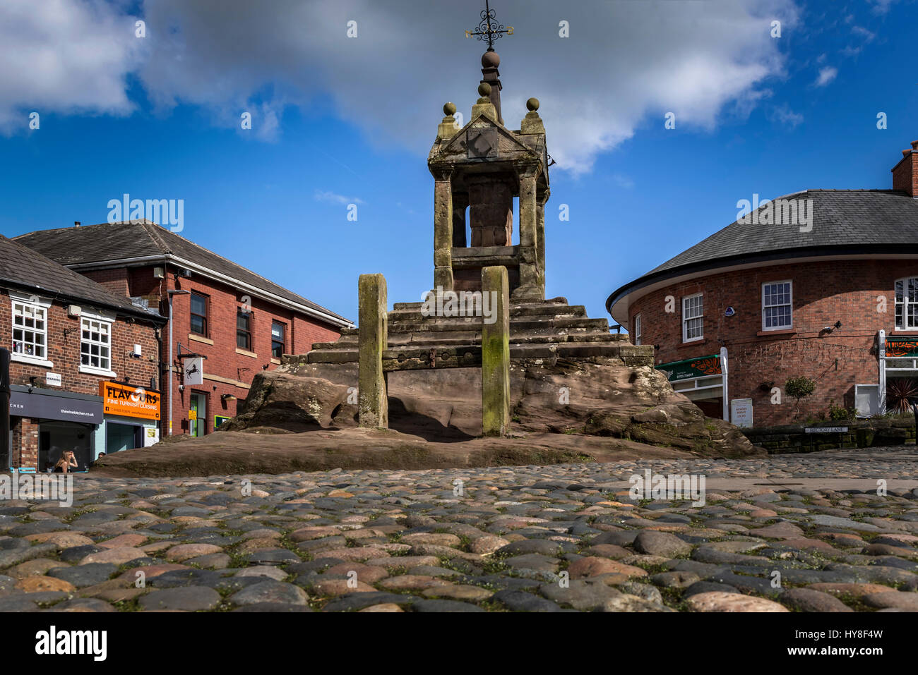 Lymm cross and cobbles.Pillory - Stock Image