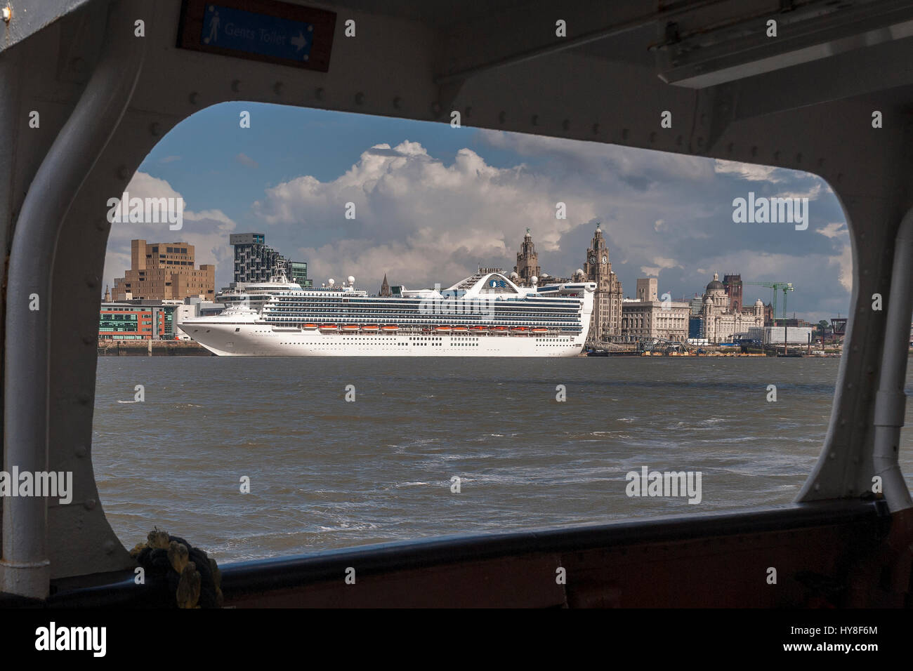 The cruise line Grand Princess seen from a Mersey ferry in Liverpool berthed at the pierhead. - Stock Image