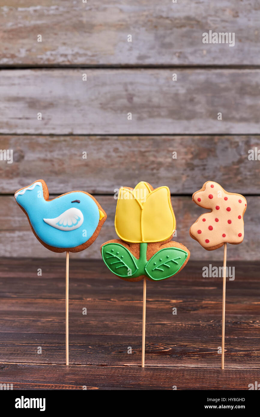 Cookies On Sticks Wooden Background Three Colorful Easter Biscuits