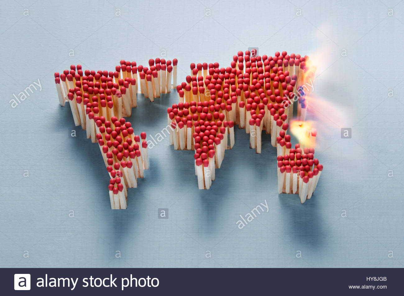 World map made of matches waiting for a spark - Stock Image