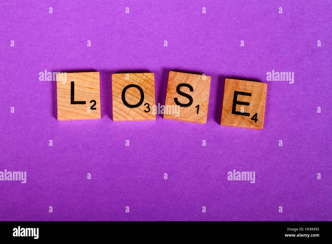 Letters spelling out the word Lose - Stock Image