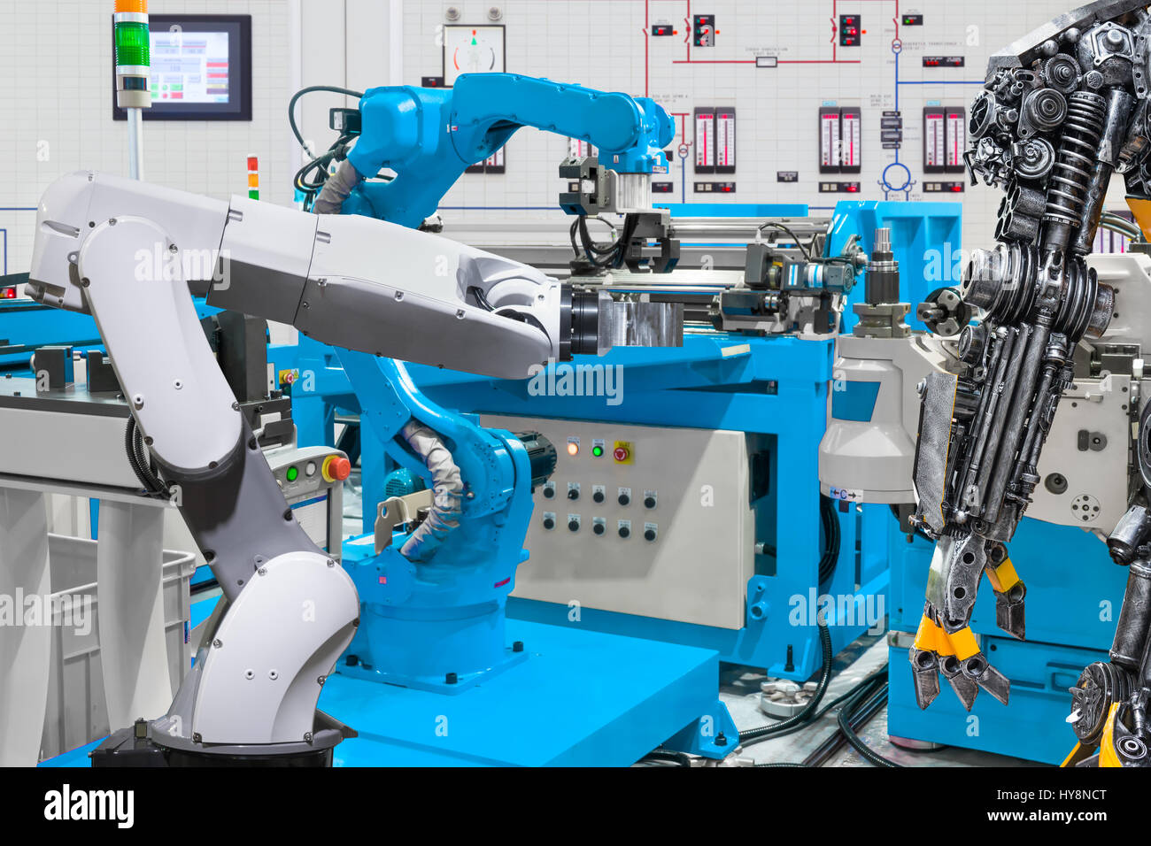 Human robot control automatic robotic hand machine tool at industrial manufacture factory, Technology robotic concept - Stock Image
