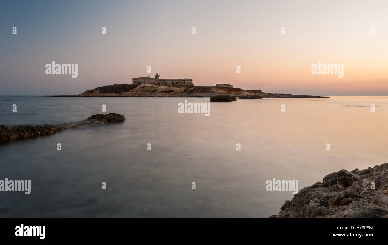 'Isola delle Correnti', the most southern point in Sicily after the sunset - Stock Image