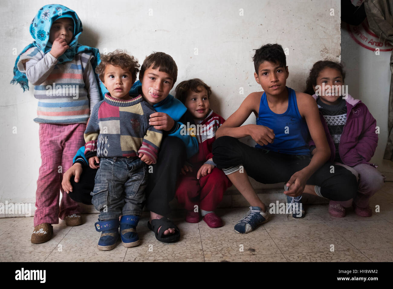 Children living in distressed district Baba Amr in Homs, Syria in early 2017 - Stock Image