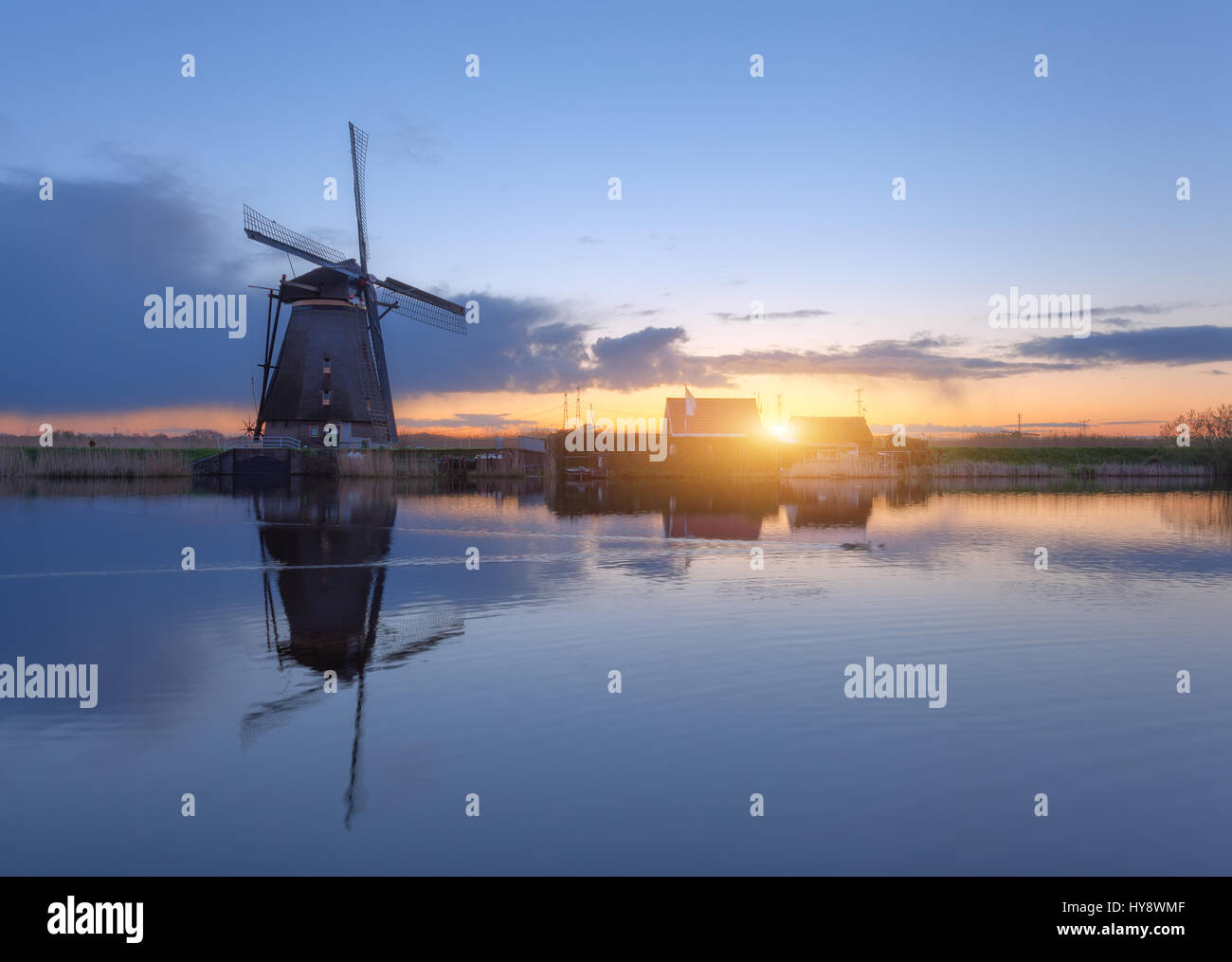 Silhouette of windmills at sunrise in Kinderdijk, Netherlands. Rustic landscape with traditional dutch windmills Stock Photo