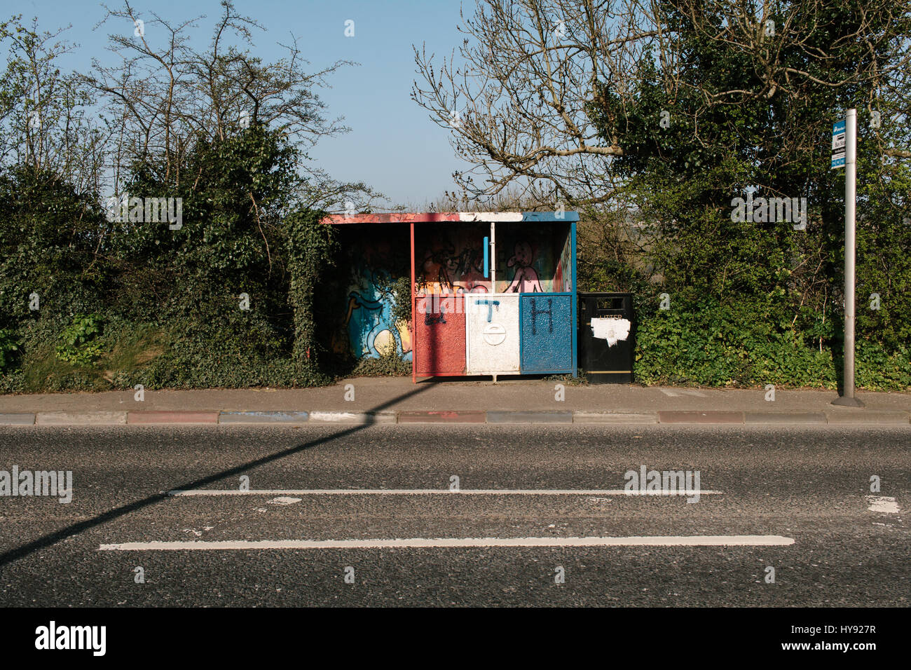 Loyalist colours painted on a bus stop near Londonderry, Northern Ireland. - Stock Image
