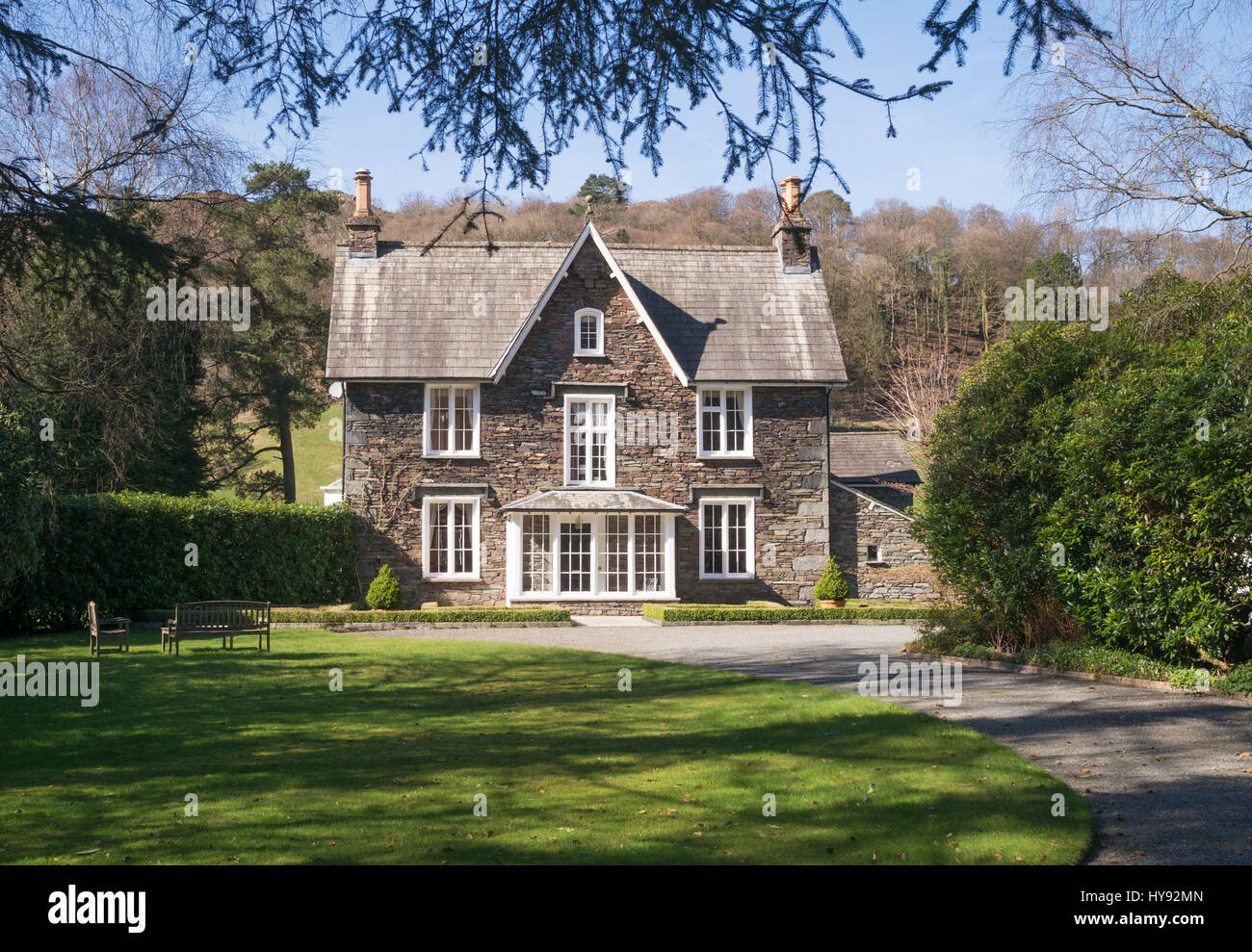 Detached lakeland stone double fronted house seen from the Coffin Route near to Grasmere, Cumbria, England, UK Stock Photo