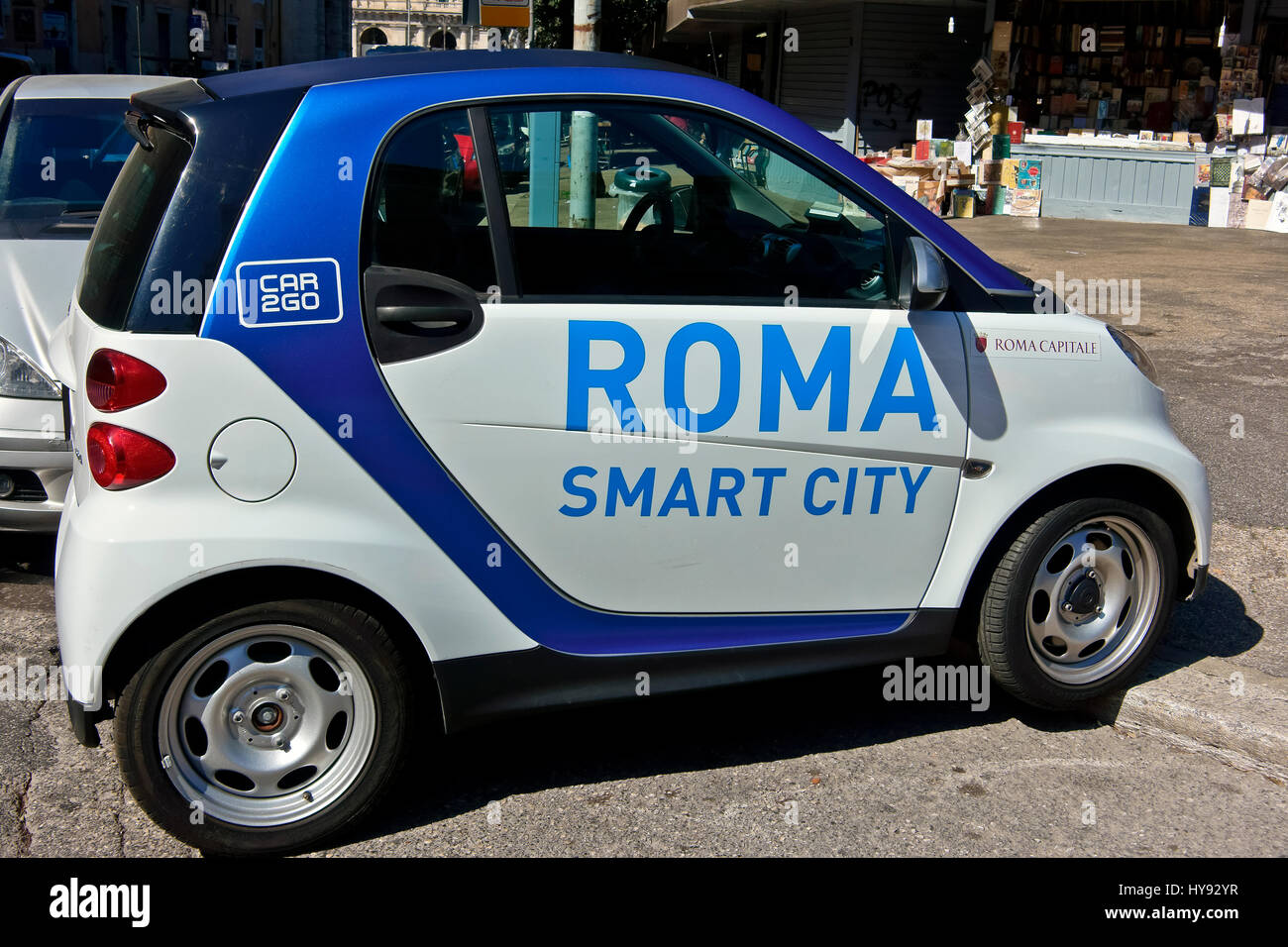 Roma smart city, Car2Go, car sharing, perpendicularly badly parked   in the street, side view. Environment transport. - Stock Image