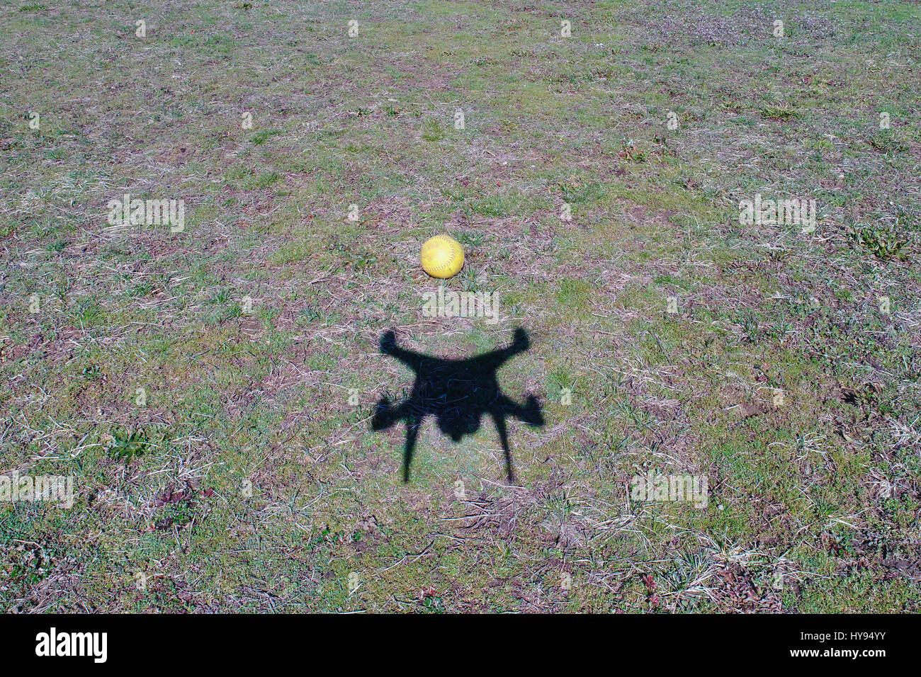 Drone taking picture of a ball , with its shadow - Stock Image