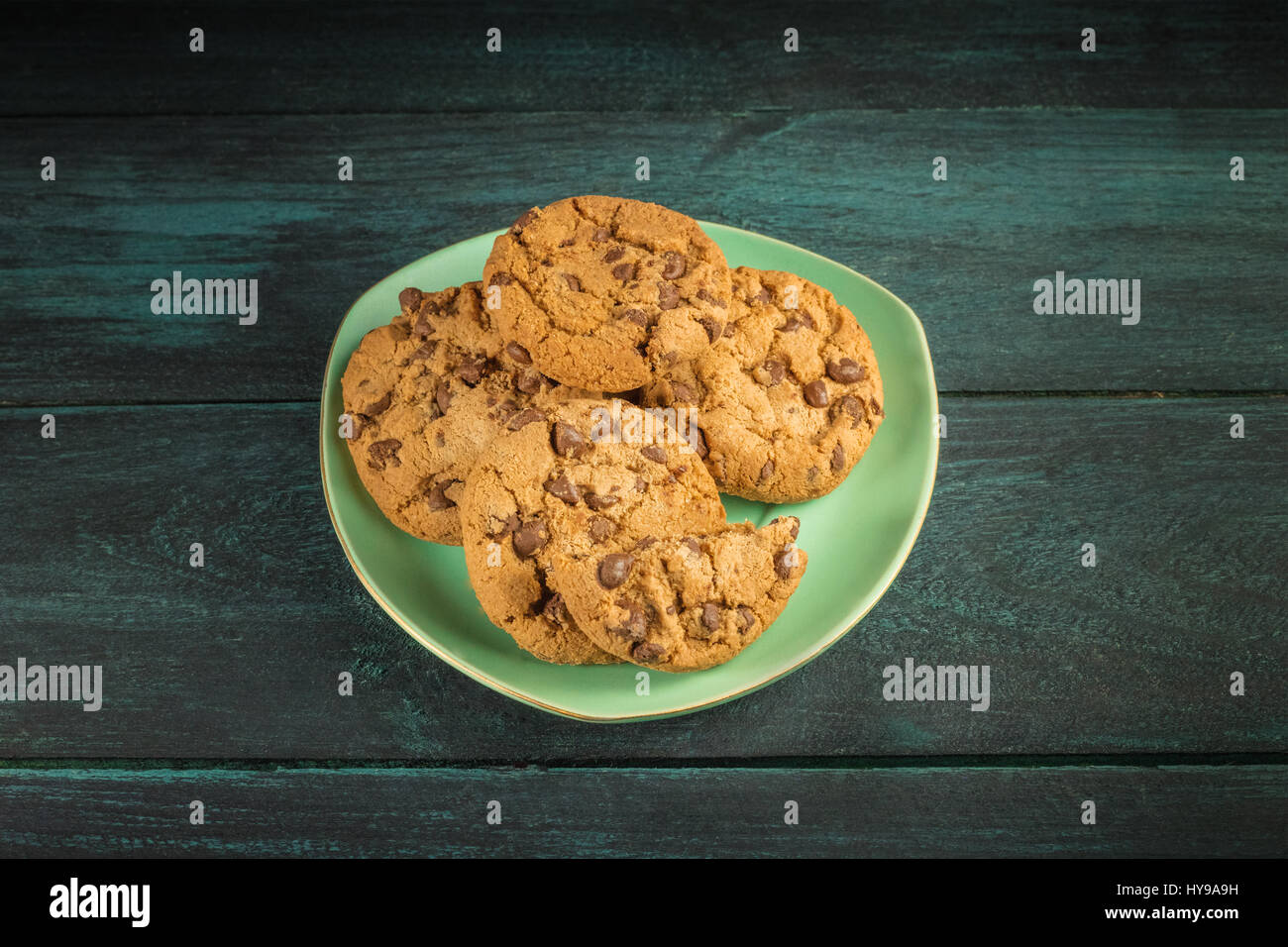 A teal plate of chocolate chips cookies with copyspace - Stock Image