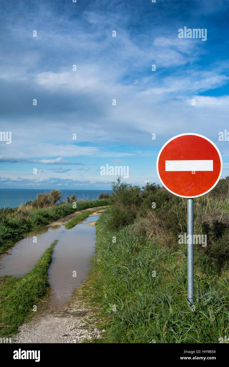 No entry sign on a French seaside dirt road - Stock Image