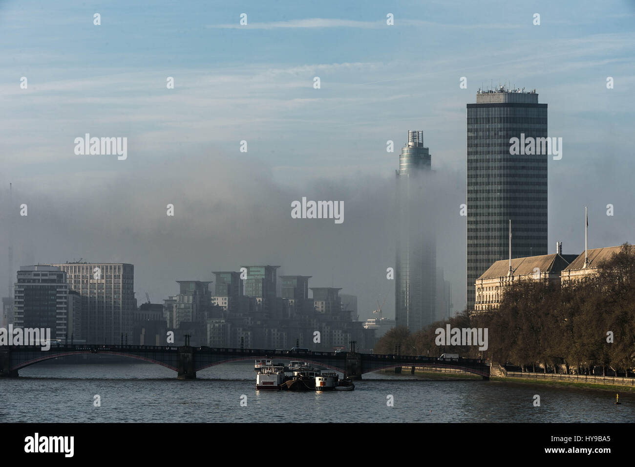 UK Weather: A dense layer of morning smog hangs over central London skyline. Buildings (R-L) Millbank Tower and Stock Photo