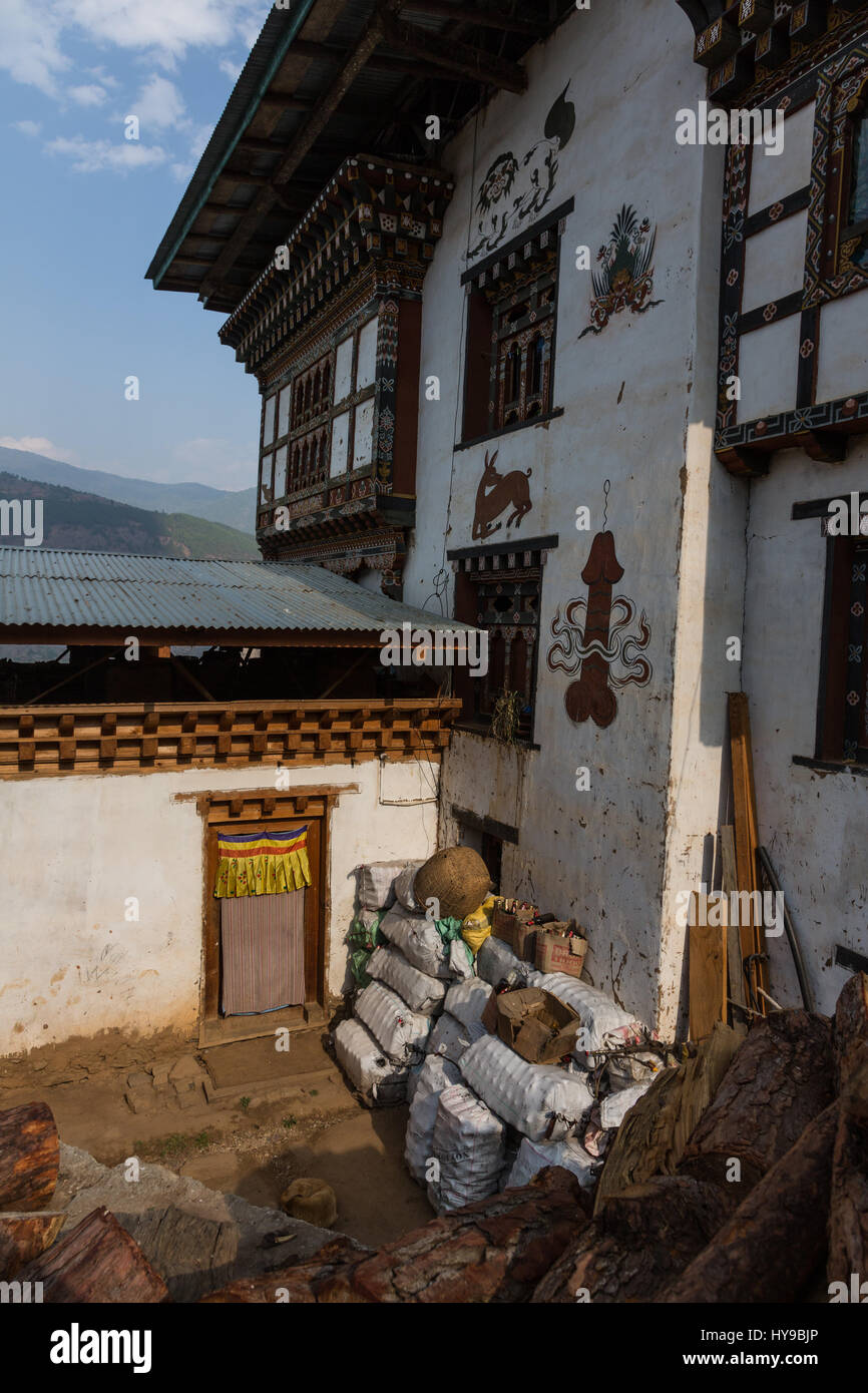House painted with Bhutanese folk art in Sopsokha, Bhutan - Stock Image