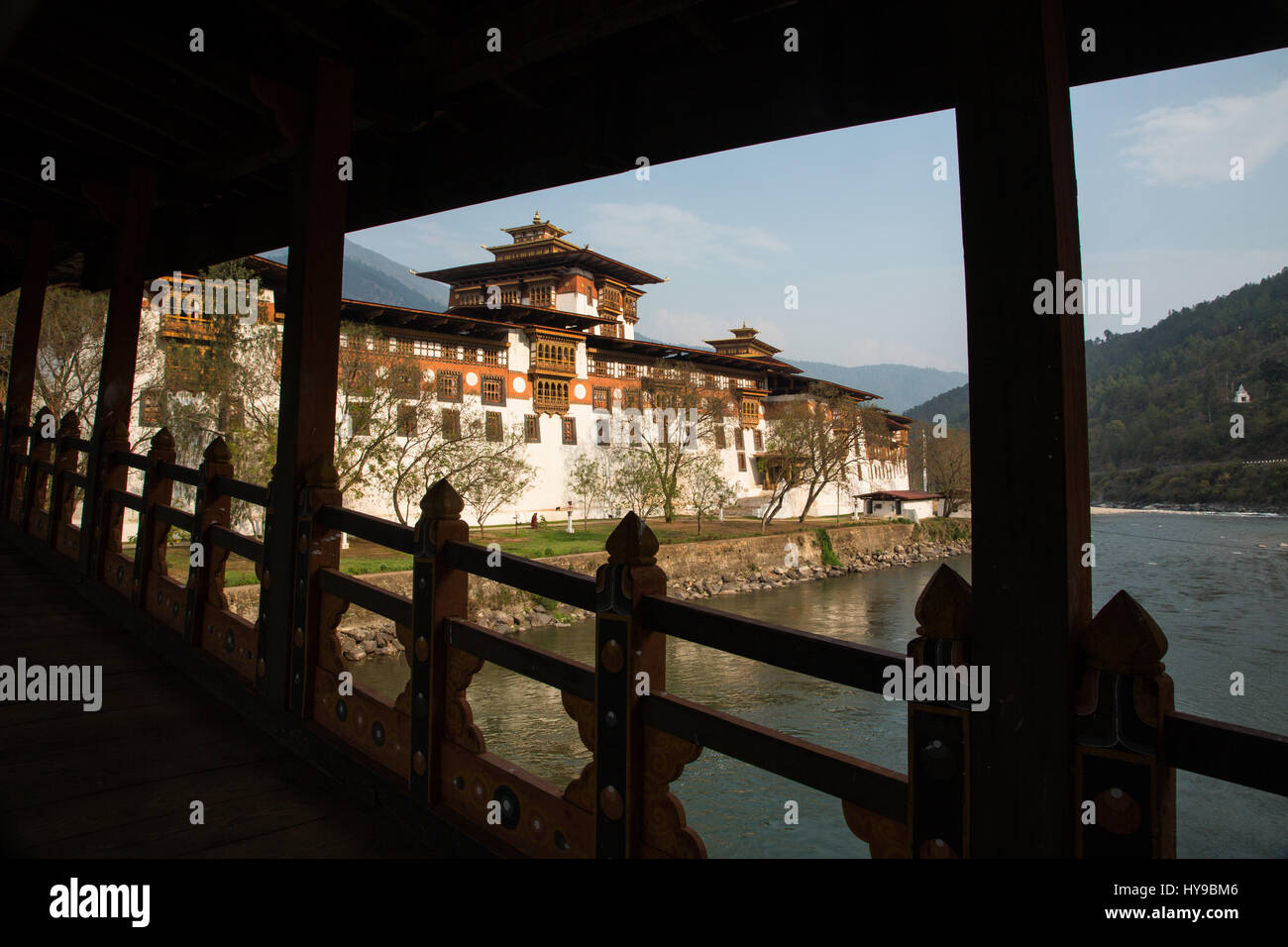 Punakha Dzong from the covered bridge over the Mo Chhu River.  Punakha, Bhutan. - Stock Image