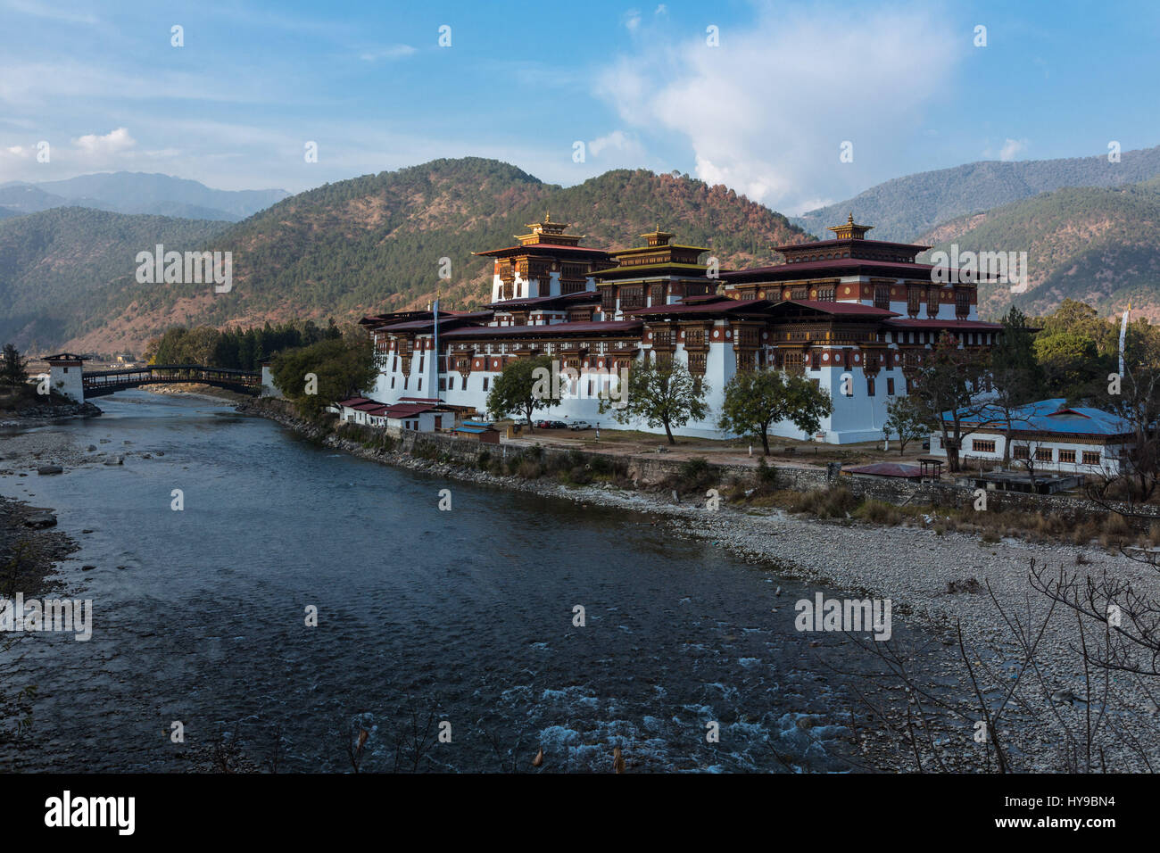 Punakha Dzong across the Mo Chhu River at first light.  Punakha, Bhutan. - Stock Image