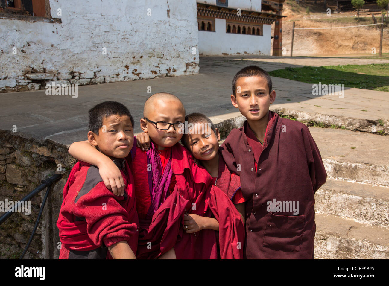 Four young novice monks in the Talo Buddhist Monastery pose for their picture.  Talo, Bhutan. - Stock Image