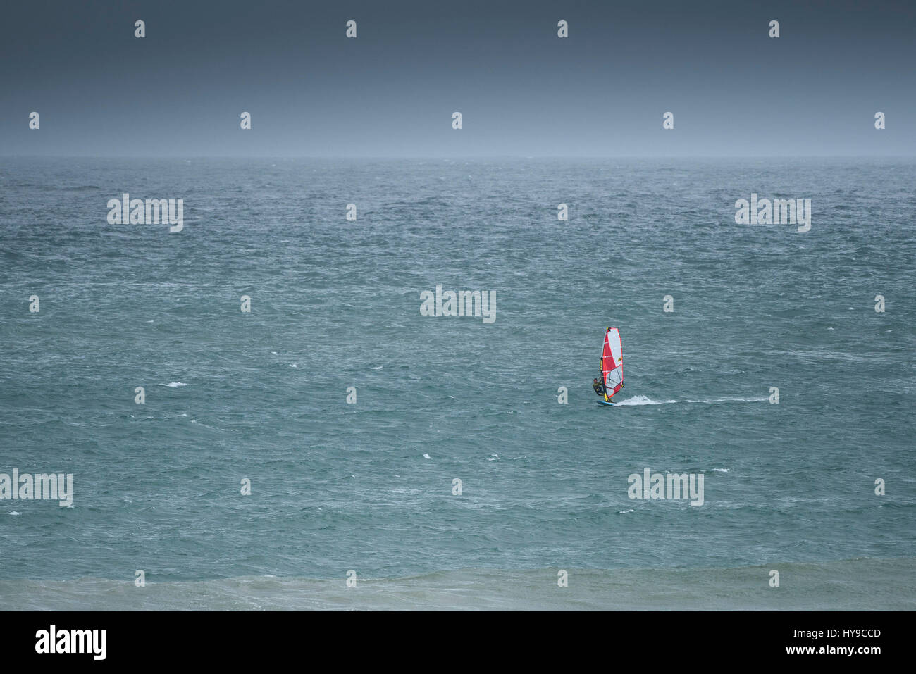 Windsurfer Sea Watersports Leisure activity Hobby Extreme sport; Ocean Skill Balance - Stock Image