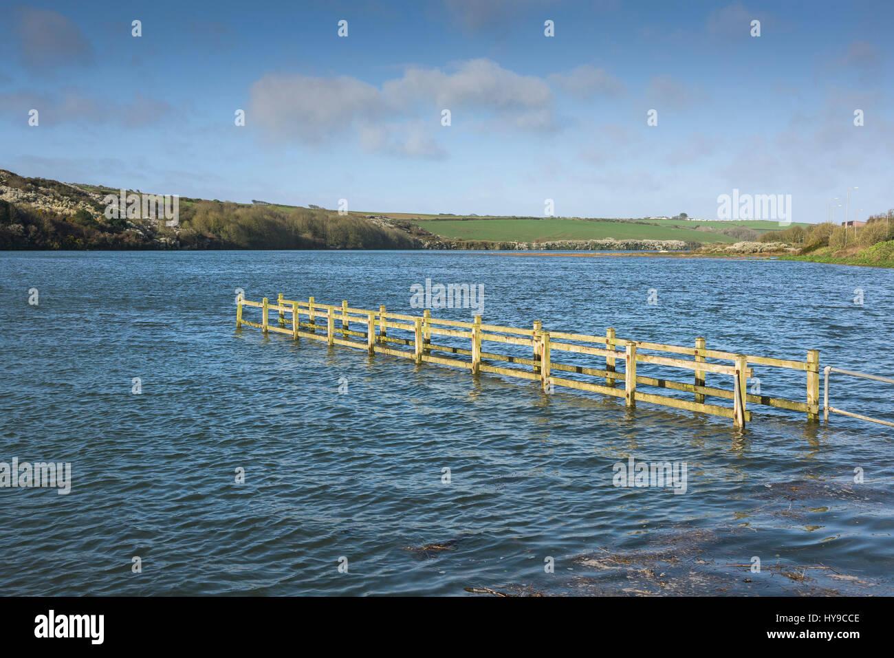 Gannel Estuary Spring tide High tide Submerged bridge Flooding Sunny Sunshine Newquay Cornwall - Stock Image
