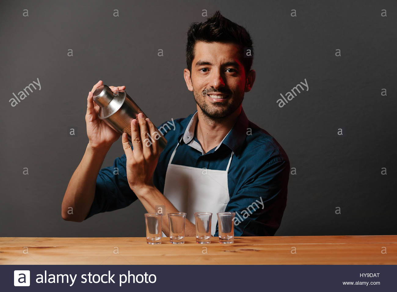 Barman makes cocktails with a shaker - Stock Image