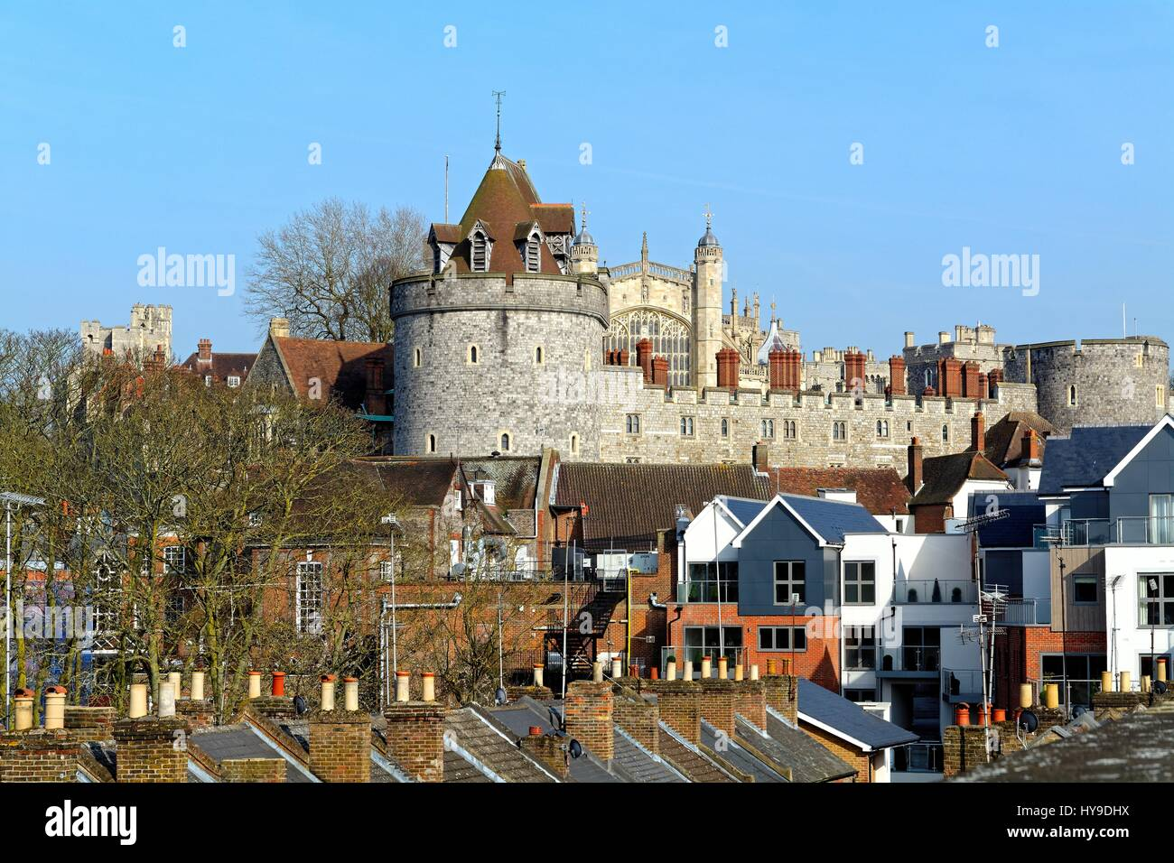 Windsor Castle on skyline of town centre Berkshire UK - Stock Image