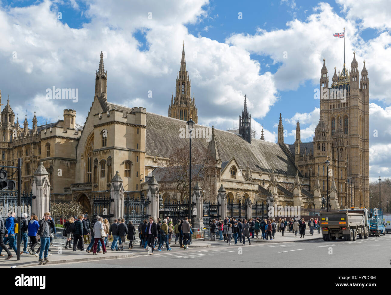 Houses of Parliament from Parliament Square with Westminster Hall in the foreground, London, England, UK - Stock Image