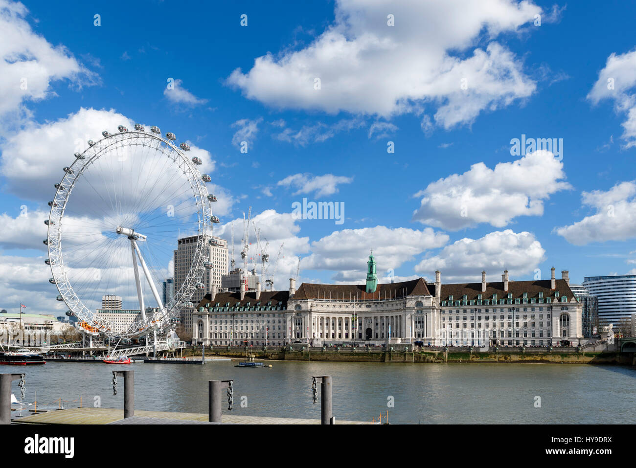 The London Eye and County Hall from Victoria Embankment, London, England, UK - Stock Image