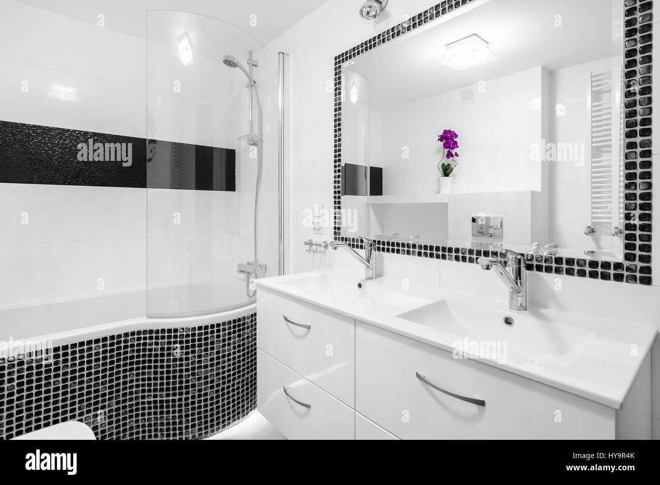 Black and white luxury bathroom with mosaic tiles, bathtub and ...