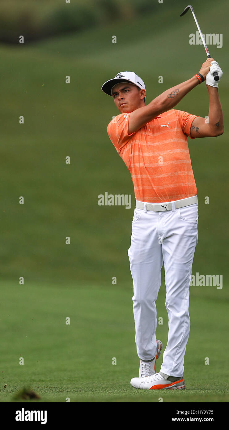 Humble, Texas, USA. 2nd Apr, 2017. Rickie Fowler hits a shot off the fairway during the fourth round of the Shell - Stock Image